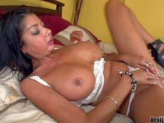 Turned on black haired sexy milf Nadia Night with enormous