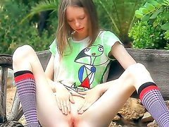 Petite cutie Gloria gets horny,strips and erotically fingers her pink pussy outdoors
