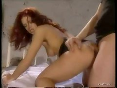 Redhead in heels wants a stiff one in her ass