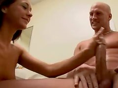 Skinny girl strokes a big cock in the bathroom