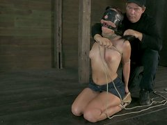 Wearing slave hood Ashli Orion kneels down for sucking a cock