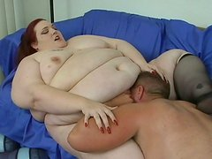 King sized BBW redhead queen Demissis deepthroats and gets doggyfucked