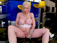 Turned on plastic pale blonde Candy Manson with huge round