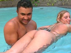Curvy exotic chick Manu Venturini shows off her juicy butt in the pool