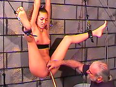 Tied babe gets a long stick in her pussy