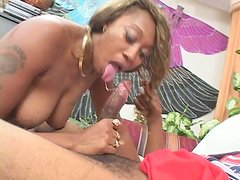 Sextractive black babe Cleo sucks a cock by the pool