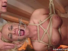 Angelic the luscious blonde slut with two guys in BDSM video