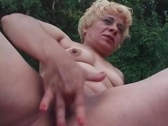 Mature blonde fucks huge dildo into her pussy