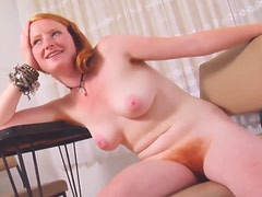 Redhead with furry bush and pits poses solo