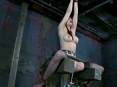 Kinky redhead slut Emily Marilyn is tied up and fucked with a powerful sex machine