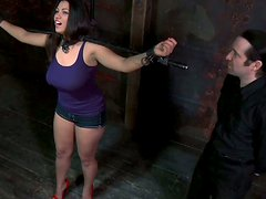 Full-bodied chick Dana Vixen stands tied up in front of cam