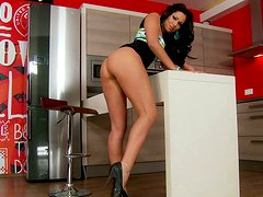 Astonishing seductress Cipriana strips taking teasing positions