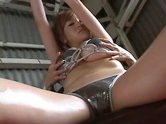 Buxom brown head Yoko Matsugane bathes in a pool squeezing her twin