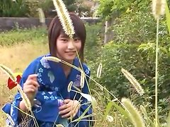 Delicate oriental teen Aika blows bubbles in geisha outfit