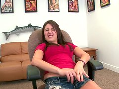 Horny bitch Missi Daniels masturbates on a chair during the interview