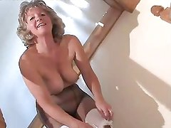 Adorable Granny In Black Pantyhose Toying On The Steps