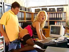 The boss fucks his gorgeous blonde office secretary in her desk