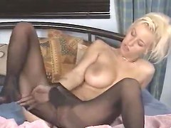 She masturbates while in black pantyhose