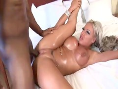 Bimbo gets a big load from the black guy