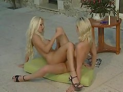 Sexy porn blondes have lesbian sex outdoors