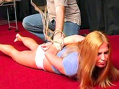 Busty blonde is lying on the floor with handcuffs