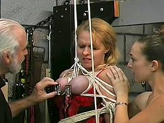 Busty babe with bondage in her tits being tortured