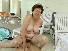 Red head granny named Abby gets banged hard by a young stud