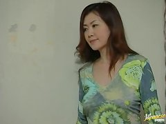 Japanese Housewife fingers her wet pussy sitting on the floor