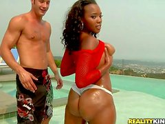 Arousing long haired young ebony beauty with nice natural hooters