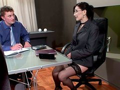 Busty brunette boss seduces her male employees for a fuck