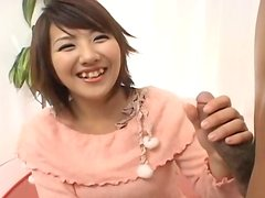 Japanese hoe Rio Megumi with fugly smile gives a handjob on cam