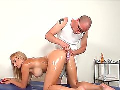 Masseur Mark Zicha is drilling Stacy Silvers butt hole with dildo during sensual oil massage session