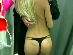 My girlfriend  is nude in the fitting room