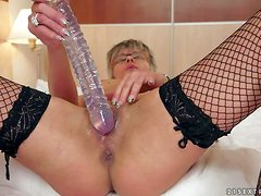 Jessye is a short haired mature woman in black fishnet