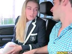 Gorgeous blonde schoolgirl sucks cock in car