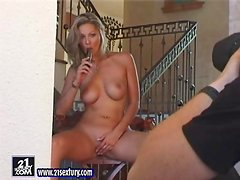 Pretty Caroline Cage plays with a dildo near a stairs