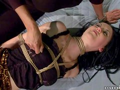 Tied up brunette Gina Lorenzza in short skirt and tiny