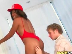 Black chick in red swimsuit licked and fucked