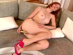 Salty red-haired chic fucks her beaver with golden dildo