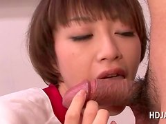 Japanese schoolgirl giving her teacher a fine blowjob