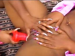 Black ladies use a strapon for sex outdoors