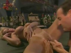 Licking her and fucking her from behind in bar