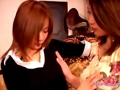 2 Asian Girls Kissing Sucking Nipples Patting While Sitting On The Armchair In The Sitting Roo