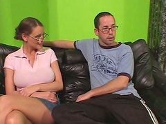 Four-eyed bitch Sandy Summers with big boobs is riding the dick upskirt