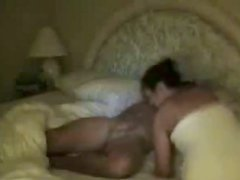 Voluptuous brunette sucks the dick of her boyfriend on the wide bed