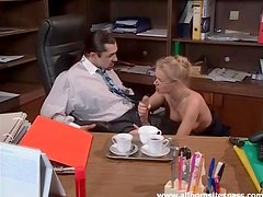 Secretary kissing and blowing her boss in office