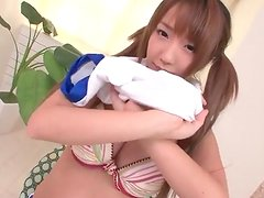 Japanese teen in pigtails shows off her cleavage