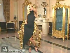 Sexy blonde Sandy slams her pussy with a cute golden dildo