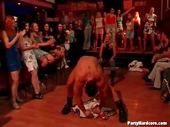 Male stripper teases the ladies at the party