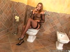 Petra Short enjoys fingering her pussy in the toilet